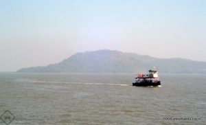Ferry returning to Mumbai from Elephanta. The Elephanta Island in the backdrop.