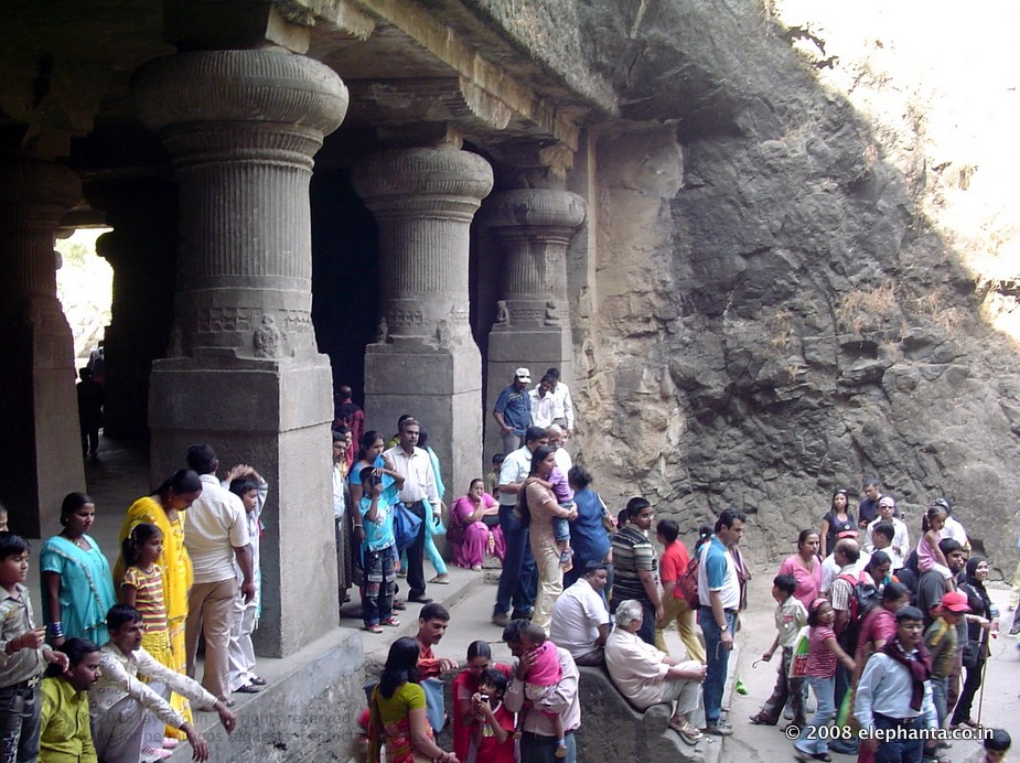Visitors outside eastern wing of Elephanta Cave 1